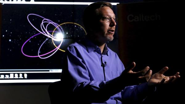 professor-of-planetary-astronomy-mike-brown-speaks-in-front-of-a-computer-simulation-of-the-probable-orbit-of-planet-nine-at-the-california-institute-of-technology-in-pasadena-california_5501427